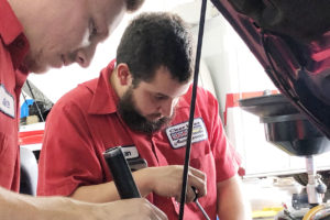 Clear Lake Auto Service Mechanics Looking Under Hood